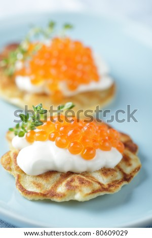 Blini with red caviar and sour cream