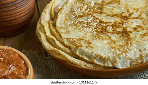 Blini, Russian pancake traditionally made from wheat, 19th century classic cuisine , assorted  dishes, Top view.