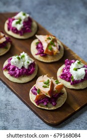 Blinis with creamy beetroot, goat cheese and hot smoked salmon