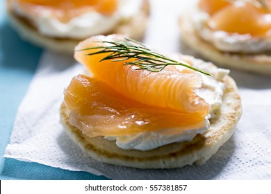 Blinis with white cream cheese and salmon