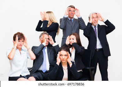 Blinkered Business Team Looking In Different Directions