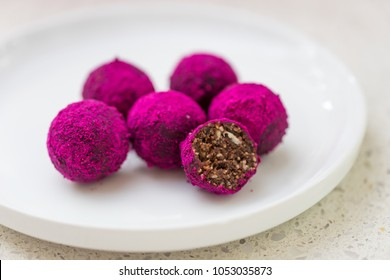 Bliss Balls coated in Beetroot Powder