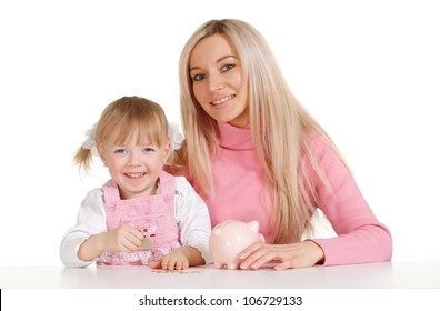 A bliss Caucasian mother with her daughter with moneybox on a white background