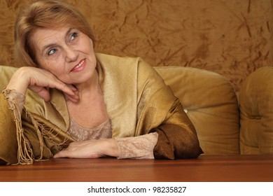 bliss woman sitting on a sofa on a brown background