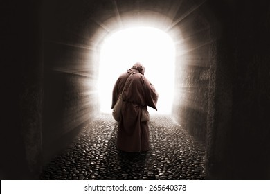 blissed Friar with faith on god walking toward the light