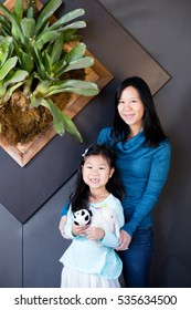 Blissful Asian Modern Family: Mom and Daughter