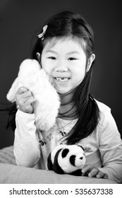 Blissful Asian Modern Family Portrait: Daughter Holding Stuff Animal Panda and Rabit