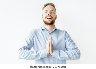 Blissful Man Keeping Hands Together and Praying