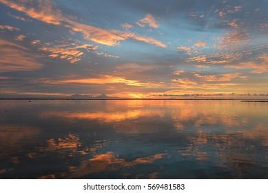 A blissful sundown on the remote island of Tikehau; a tiny atoll located in the Tuamotu Archipelago, French Polynesia, South Pacific