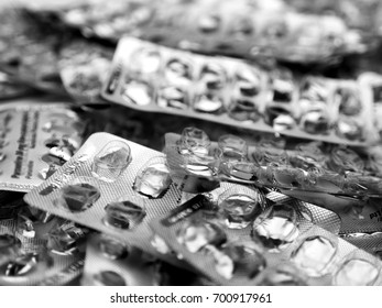 Blister Packs; background of empty foil tablet packs; differential focus