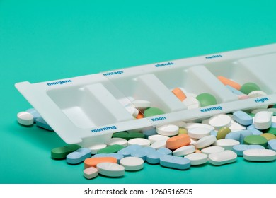 Blister of tablets isolated on a bright green background
