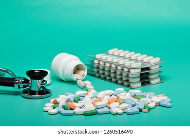 Blister of tablets isolated on a briht green background