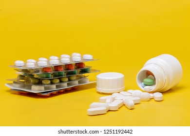 Blister of tablets isolated on a yellow background