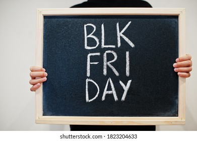 Blk fri day written on blackboard. Black friday concept. Boy hold board.