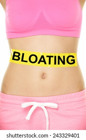 Bloating in stomach abdomen. BLOATING text written on female stomach. Bloated due to food diet conceptual image.