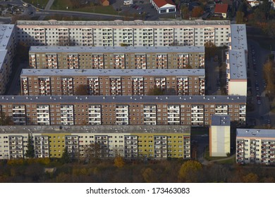 block of buildings in a residential area from above