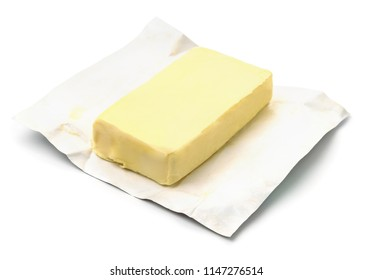 Block butter in open wrapping isolated on white