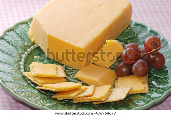 Block Cheese On Green Plate Crackers Stock Photo (Edit Now