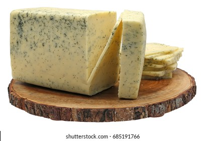 Block of cheese sliced on a wooden board