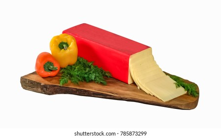 Block of edam cheese and slices . Clipping path.