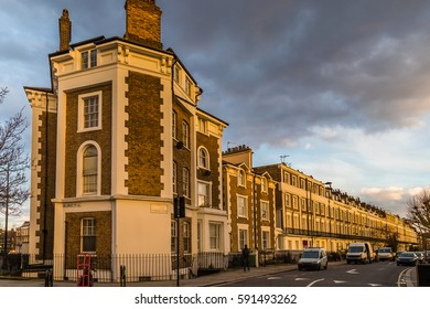Block of flats in london at a corner during the sunset giving a very warm colors in a overcast day.