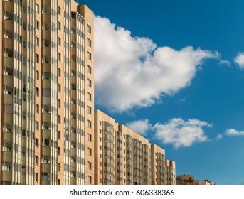 Block of flats social buildings against cloudy blue sky