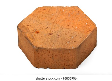 A block of pentagon shaped fired brick on white isolation