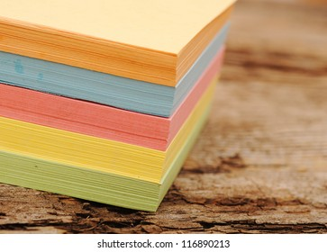 block of post-it notes on old wooden background