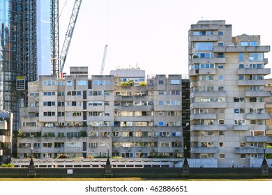 Block of riverfront flats in geometric brutalist style in London