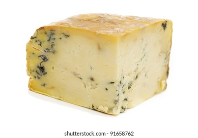 Block of Stilton Cheese on a white background.