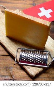Block of Swiss hard cheese Le Gruyere used for traditional fondue and gratin, close-up