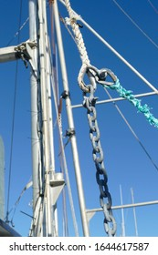 Block and tackle for rigging and anchor on fishing boat in the Yaquina marina,  Newport, Oregon