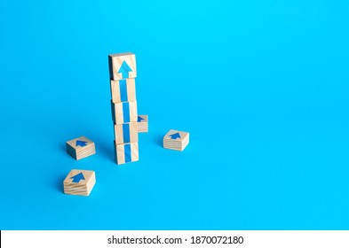 Block tower with arrows. Business growth and development concept. Achieve success. Building career advancement, improving skills. Goal achievement. Progress and movement forward. Self improvement