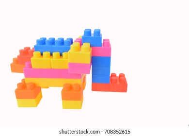 Block toys are multi-colored elephants for brain development, isolated white background.