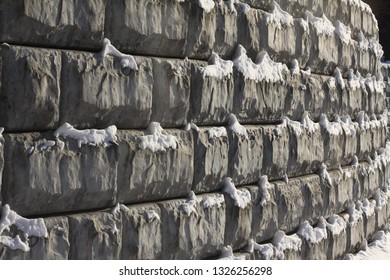 Block walls covered in snow in winter time.