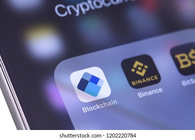 Blockchain app and Binance - cryptocurrency exchange icons on the screen smartphone. Moscow, Russia - October 14, 2018