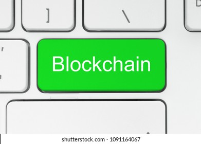 Blockchain concept. Red button with Blockchain word on the keyboard close-up.
