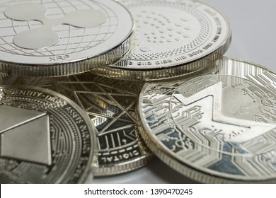 Blockchain cryptocurrency physical coins surrounded with variety of other crypto altcoins.