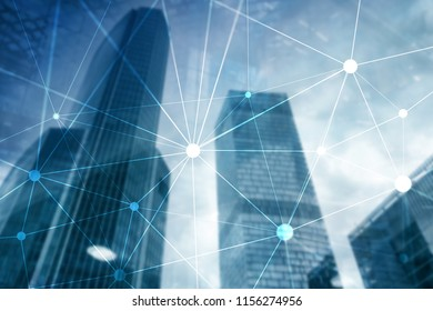 Blockchain network on blurred skyscrapers background. Financial technology and communication concept.