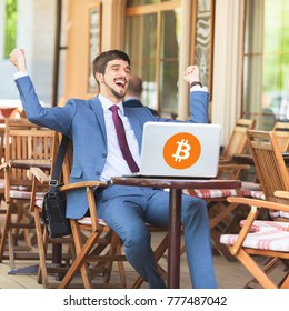 Blockchain technology. Bitcoin cryptocurrency. Succesful man hands up. Using laptop. Concept of success