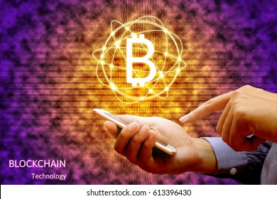 Blockchain technology concept, Businessman holding smartphone and virtual system diagram bitcoin