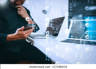 Blockchain technology concept with diagram of chain and encrypted blocks.businessman working with smart phone and digital tablet and laptop computer in modern office