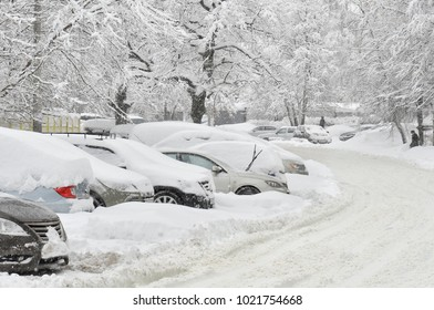 Blocked cars after heavy snow storm.Covered by snow cars after heavy snowfall at the parking.