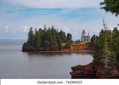 Blockhouse Point Lighthouse, located on Rocky Point on the west side of the Charlottetown Harbour entrance, Prince Edward Island, Canada  A historic building