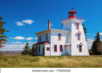 Blockhouse Point Lighthouse on Prince Edward Island and Charlottetown panorama. Prince Edward Island, Canada.