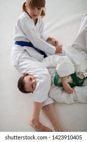 Blocking boy. Talented active girl loving aikido blocking boy while having aikido battle