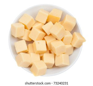 blocks of cheese in a bowl isolated on a white background