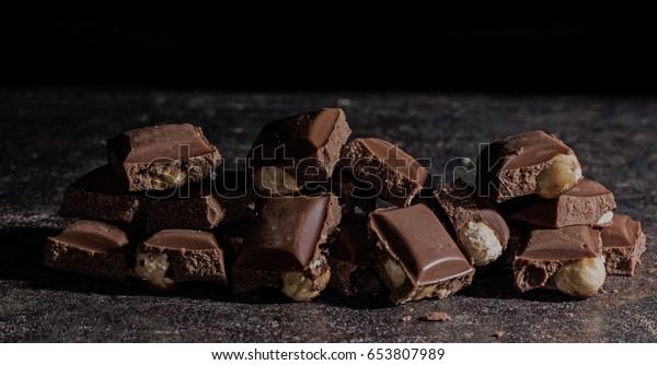 Blocks of chocolate containing hazelnuts