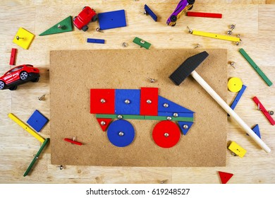 Blocks, hammer and nails on a table colorful background . Top view.