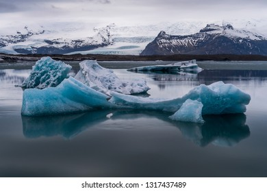 Blocks of ice floating on the waters of the Jökulsárlón Lagoon at dusk, Iceland